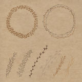 Set of decorative. Doodle wreaths made of branches. Two wreaths from plants and six different branches. background kraft Royalty Free Stock Image