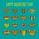 Set of decorative hearts with different bright colorful patterns on a blue-green background Stock Photo