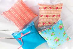 Set decorative pillows scented sachets and oranges Stock Photos