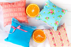 Set decorative pillows scented sachets and oranges Royalty Free Stock Image