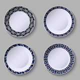 Set of decorative plates with a blue ornament of handwork and a empty space in the center. Royalty Free Stock Image