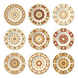 Set of decorative plates with a orange pattern Stock Photos