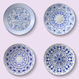 Set of decorative porcelain dishes with blue ethnic pattern in the style of Chinese painting on porcelain Stock Photo
