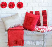 Set of decorative red pillows. Of different size, interior decoration ideas Stock Photo