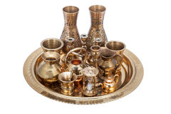 Set of decorative souvenirs from copper and bronze on a tray Stock Photography