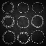 Set of decorative wreaths doodle. Nine wreaths from plants. Background chalk board Stock Image