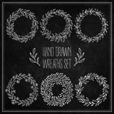 Set of decorative wreaths drawn in chalk on a Stock Photos