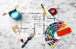 Set of decorator`s tools and project drawing. On light background, flat lay Royalty Free Stock Photography