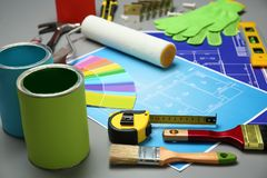 Set of decorator`s tools and project drawings. On table Royalty Free Stock Photography