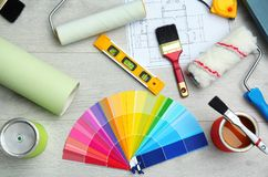Set of decorator`s tools. On wooden floor stock photography