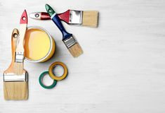 Set of decorator`s tools on wooden background. Flat lay Royalty Free Stock Image