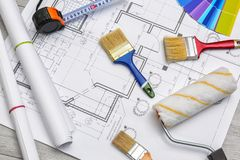 Set with decorator tools and items. On house plan stock photos