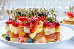 Set of delicious canapes with strawberry Stock Images