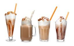 Set with delicious caramel milk shakes. On white background stock photos