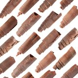 Set of delicious chocolate curls on white. Background stock images