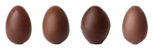 Set of delicious chocolate Easter eggs. On white background royalty free stock photography