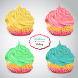 Set of delicious cupcakes with different toppings Stock Images