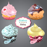 Set of delicious cupcakes with different toppings Royalty Free Stock Photos