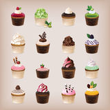 Set of 16 delicious cupcakes Royalty Free Stock Photos