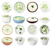 Set of delicious sour cream with herbs in bowls on white. Background royalty free stock photography