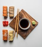 Set of delicious sushi with ginger, soy sauce and wasabi on a white background royalty free stock image