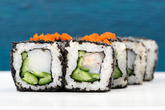 Set of delicious sushi rolls with white fish and cucumber in bla Stock Photos