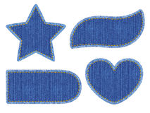Set of denim patches. Set of blue denim patches with stitch. Different shapes with place for your text  on white background Stock Images