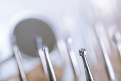 Set of dental drills with mirror in the background. Close up Stock Photo
