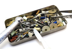 Set dental instruments: cutters, needles, drills, scalpel, forceps in a metal box isolated. On white Royalty Free Stock Images