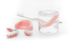 Set of Denture in glass of water on white background.  Royalty Free Stock Photography