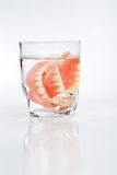 A set of dentures in a glass of water Stock Photography