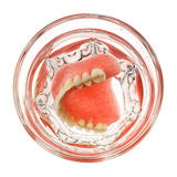 A set of dentures in a glass of water Royalty Free Stock Images