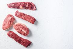Set of denver, top blade, tri tip steak, machete, flank, bavette London broil marble beef on white background top view space for