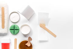 Set for depilation with wax on white background top view copyspace Stock Image