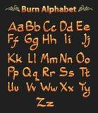 Set des gebrannten Alphabetes der Zahl Stockfotografie