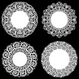 Set of design elements, lace round paper doily, doily to decorate the cake, template for cutting, snowflake, greeting element, met. Al plate cut by laser Royalty Free Stock Photo