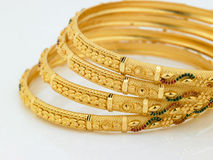 Set of designed gold bangles Royalty Free Stock Photography