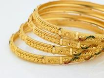 Set of designed gold bangles. Set of four designed gold bangles Royalty Free Stock Photography