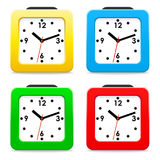 Set desktop alarm clocks square shape with red, yellow, green, and blue body. Isolated objects on a white background. Vector Image. Set desktop alarm clocks Stock Photography