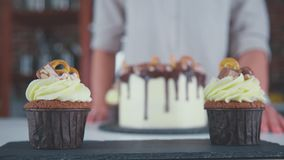 Set of desserts for the holiday table. Cupcakes in hand. stock video footage