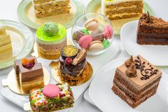 Set of desserts. Set of different cakes sweets and desserts arranged on one plate to celebration royalty free stock photo