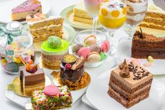 Set of desserts. Set of different cakes sweets and desserts arranged on one plate to celebration stock photography