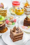 Set of desserts. Set of different cakes sweets and desserts arranged on one plate to celebration royalty free stock photos