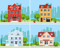 Set of detailed colorful modern cottage houses with trees and city background. Graphic buildings. Vector illustration. stock illustration