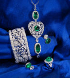 Set of the diamond and emerald jewelry. The set of elegant emerald and diamond jewelry Stock Photos