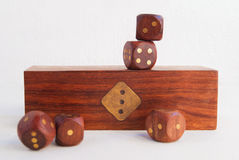 Set of dice on the background of a wooden box Royalty Free Stock Photo