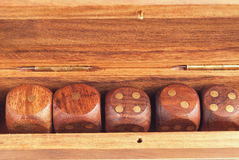 Set of dice in a wooden box close-up stock photography