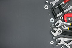 Set of different adjustable wrenches and clamps on grey table Royalty Free Stock Photo