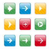 Set of different arrows on glass buttons. Stock Images