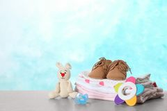 Set of different baby accessories and toys on table. Space for text stock photography